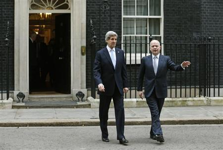 U.S. Secretary of State John Kerry (L) and Britain's Foreign Secretary William Hague leave Number 10 Downing Street in London February 25, 2013. REUTERS/Suzanne Plunkett