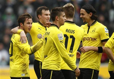 Borussia Dortmund's Mario Goetze (L) and team mates celebrate a goal against Borussia Moenchengladbach during the German first division Bundesliga soccer match in Moenchengladbach February 24, 2013. REUTERS/Ina Fassbender
