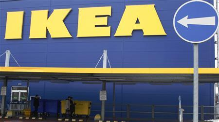 People walk alongside an IKEA outlet in Prague, February 25, 2013. Swedish furniture giant IKEA said on Monday it has stopped selling meatballs from a specific batch which has tested positive for traces of horsemeat by Czech authorities. REUTERS/Petr Josek