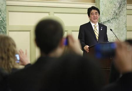 Japan's Prime Minister Shinzo Abe makes remarks at a reception with Japan-US Cultural Exchange Representatives in Washington, February 22, 2013. REUTERS/Jonathan Ernst