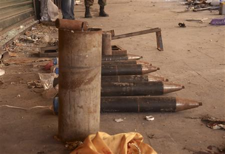 Ammunition which forces loyal to Syrian President Bashar al-Assad believe belongs to the Free Syrian Army is seen at Al-Suwayqa neighborhood in the old city of Aleppo after the forces captured this area from the Free Syrian Army February 25, 2013. REUTERS/George Ourfalian