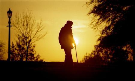 An elderly man makes his way down Primrose Hill in London as the sun sets November 12,1997.