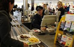 A customer buys lunch at the IKEA cafeteria in Prague, February 25, 2013. REUTERS/Petr Josek