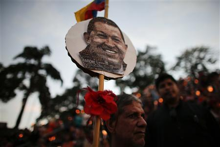 A man participates at a praying ceremony for the health of Venezuelan President Hugo Chavez in Caracas February 22, 2013. REUTERS/Jorge Silva