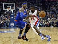 Detroit Pistons point guard Will Bynum (12) drives the ball past New York Knicks small forward Carmelo Anthony (7) during their regulation NBA basketball game played in 02 Arena in London, England January 17, 2013. REUTERS/Suzanne Plunkett