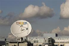 "A satellite dish of RTL Television is seen on the roof of the former RTL headquarters in Cologne November 12, 2012. Media conglomerate Bertelsmann and its RTL Group warned the economic crisis in Europe would weigh on earnings this year as companies spend less on advertising. RTL Group, majority owned by Bertelsmann, earlier said it still expected its 2012 operating profit to drop, citing an ""increasingly tough economic environment"". And while the euro zone crisis has started to hit the German economy, RTL said its TV advertising sales slightly increased in Europe's biggest economy. Picture taken November 12. REUTERS/Wolfgang Rattay (GERMANY - Tags: BUSINESS MEDIA) - RTR3ACCE"