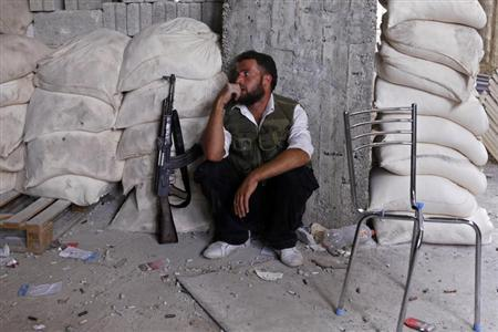 A member of the Free Syrian Army rests at a front line in the Hanano area of Aleppo city in northern Syria October 10, 2012. REUTERS/Zain Karam