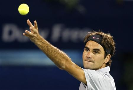 Roger Federer of Switzerland serves to Malek Jaziri of Tunisia during their men's singles match at the ATP Dubai Tennis Championships, February 25, 2013. REUTERS/Mohammed Salem