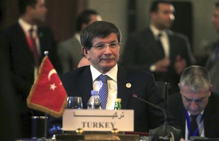 Turkish Foreign Minister Ahmet Davutoglu attends a foreign ministers meeting ahead of the Organisation of Islamic Cooperation (OIC) summit in Cairo February 4, 2013. REUTERS/Mohamed Abd El Ghany