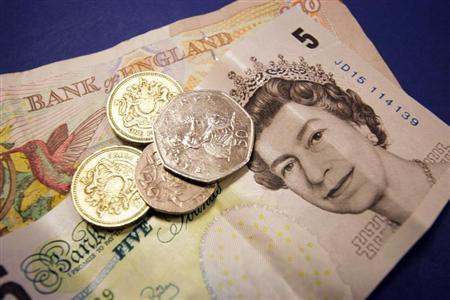 Some British sterling money in coins and bank notes is seen September 2, 2005. BANKG REUTERS/Catherine
