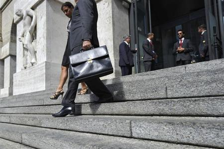 People leave the stock exchange in downtown Milan September 13, 2012. REUTERS/Paolo Bona