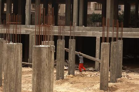 A builder works at a new construction site in Cairo, in this file photo taken February 28, 2012. REUTERS/Asmaa Waguih
