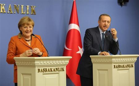 German Chancellor Angela Merkel and Turkey's Prime Minister Tayyip Erdogan (R) attend a joint news conference in Ankara February 25, 2013. REUTERS/Altan Burgucu