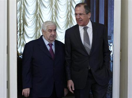 Russia's Foreign Minister Sergei Lavrov (R) and his Syrian counterpart Walid al-Moualem walk into a hall during a meeting in Moscow, February 25, 2013. REUTERS/Sergei Karpukhin