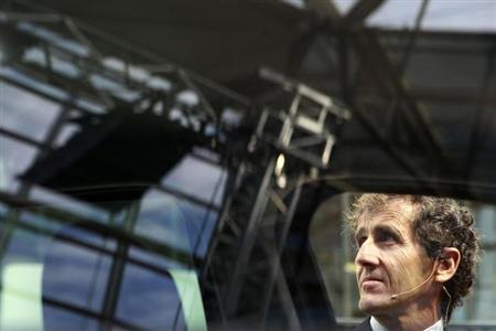 Former Formula One French World Champion Alain Prost is seen through the windows of the Dacia Duster during its launch in Bucharest March 18, 2010. REUTERS/Bogdan Cristel/Files