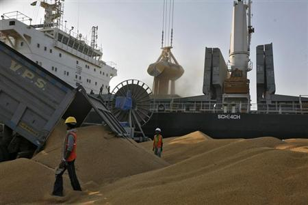 A dumper unloads wheat as a crane loads onto a cargo ship at the Mundra port in the western Indian state of Gujarat September 24, 2012. REUTERS/Amit Dave