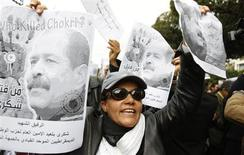 A woman chants slogans and holds pictures of assassinated leftist politician Chokri Belaid during a demonstration against the Islamist Ennahda movement in Tunis February 23, 2013. REUTERS/Zoubeir Souissi