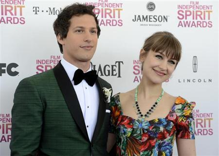 Host Andy Samberg and his girlfriend, musician Joanna Newsom, arrive at the 2013 Film Independent Spirit Awards in Santa Monica, California February 23, 2013. REUTERS/Phil McCarten