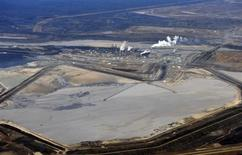 The Suncor tar sands plant and tailings pond at their tar sands operation north of Fort McMurray, Alberta, November 3, 2011. REUTERS/Todd Korol