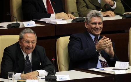 Cuba's President Raul Castro and newly elected first vice president Miguel Diaz Canel, (R), attend the closing session of the National Assembly of the Peoples Power in Havana February 24, 2013. REUTERS/Desmond Boylan