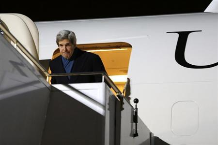 U.S. Secretary of State John Kerry ducks under the doorway as he arrives at Tegel International Airport in Berlin, February 25, 2013. REUTERS/Jacquelyn Martin/Pool