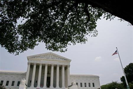 The U.S. Supreme Court building in Washington is seen shortly after Justice Sandra Day O'Connor submitted a letter of resignation to President George W. Bush, July 1, 2005. REUTERS/Shaun Heasley