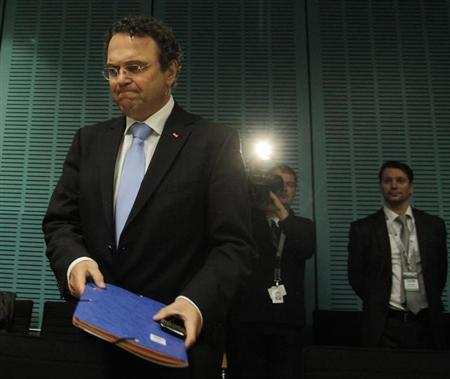 German Interior Minister Hans-Peter Friedrich arrives for a conference with German regional state interior ministers on banning the far-right National Democratic party (NPD), in Berlin March 22, 2012. REUTERS/Tobias Schwarz (GERMANY - Tags: POLITICS) - RTR2ZPWV