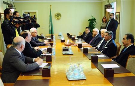 George Sabra, head of Syrian Opposition Coalition (4th L) and Abdel Baset Sida (3rd L) , former president of the coalition meet with the Secertery General of the Arab league, Nabil Elaraby (3rd R) in Cairo February 24, 2013. REUTERS/Stringer