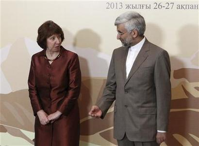 European Union foreign policy chief Catherine Ashton (L) and Iran's Supreme National Security Council Secretary and chief nuclear negotiator Saeed Jalili meet before the talks in Almaty February 26, 2013. World powers began talks with Iran on its nuclear programme in the Kazakh city of Almaty on Tuesday, in a fresh attempt to resolve a decade-old standoff that threatens the Middle East with a new war. REUTERS-Stanislav Filippov-Pool