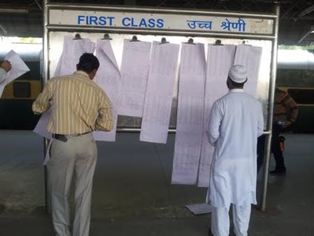 Passengers check their names on a boarding chart at New Delhi's railway station, Feb 26, 2013. REUTERS/Arnika Thakur