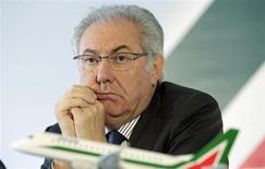 "Alitalia president Roberto Colaninno attends a news conference during the presentation of new Alitalia jet "" Embraer E-jet 190"" at Leonardo da Vinci airport in Fiumicino, October 6, 2011. REUTERS/Remo Casilli"