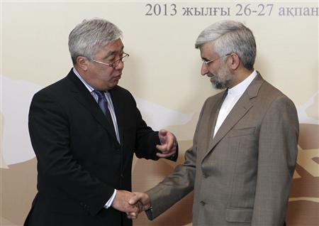 Kazakhstan's Foreign Minister Yerlan Idrisov (L) greets Iran's Supreme National Security Council Secretary and chief nuclear negotiator Saeed Jalili before the talks in Almaty February 26, 2013. World powers began talks with Iran on its nuclear programme in the Kazakh city of Almaty on Tuesday, in a fresh attempt to resolve a decade-old standoff that threatens the Middle East with a new war. REUTERS/Stanislav Filippov/Pool