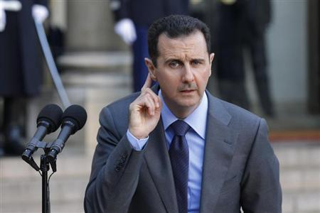 Syria's President Bashar al-Assad answers journalists after a meeting at the Elysee Palace in Paris, December 9, 2010. REUTERS/Benoit Tessier