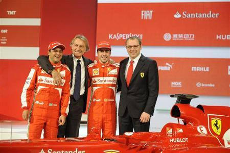 Ferrari boss Luca Cordero di Montezemolo (2nd L) poses with Ferrari Formula One drivers Fernando Alonso (2nd R) of Spain, Felipe Massa of Brasil and Ferrari Formula One team principal Stefano Domenicali (R) during a presentation of the new Ferrari F138 Formula One car in this official undated handout image distributed by the Ferrari Press Office February 1, 2013. REUTERS/Ferrari Press Office/Handout