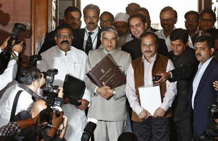 Railway Minister Pawan Kumar Bansal (C) arrives to present the annual budget for the country's railway system, at the parliament in New Delhi February 26, 2013. REUTERS/Adnan Abidi