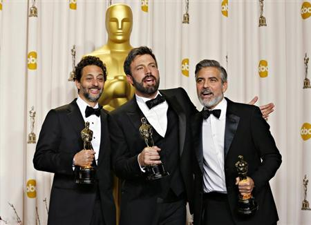 Best picture winner ''Argo'' producers George Clooney (R), Grant Heslov and Ben Afleck (C) pose with their awards at the 85th Academy Awards in Hollywood, California February 24, 2013 REUTERS/ Mike Blake