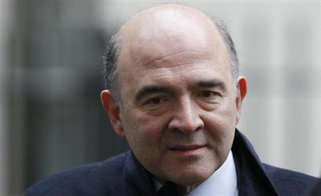 France's Economy, Finance and Foreign Trade Minister Pierre Moscovici leaves 11 Downing Street in London February 25, 2013. REUTERS/Suzanne Plunkett