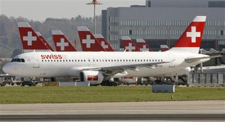 An aircraft of Swiss flag carrier Swissair taxis to take off at Zurich airport October 20, 2008. REUTERS/Arnd Wiegmann