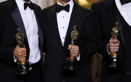 Best Picture winner ''Argo'' producers George Clooney, Grant Heslov and Ben Afleck (L-R) pose with their awards at the 85th Academy Awards in Hollywood, California February 24, 2013. REUTERS/ Mike Blake