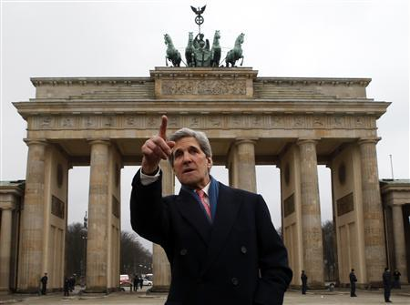U.S. Secretary of State John Kerry gestures as he stands in front of the Brandenburg Gate in Berlin February 26, 2013. REUTERS/Fabrizio Bensch
