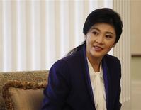 Thai Prime Minister Yingluck Shinawatra smiles during her meeting with Hong Kong Chief Executive Leung Chun-ying in Hong Kong February 26, 2013. REUTERS/Bobby Yip (CHINA - Tags: POLITICS) - RTR3EANV
