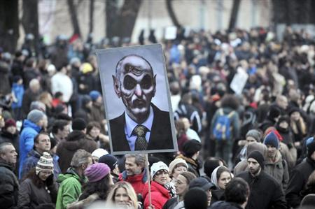 A sign with a caricature of Slovenia's Prime Minister Janez Jansa is seen during an anti-austerity and anti-corruption protest in Ljubljana February 8, 2013. REUTERS/Srdjan Zivulovic