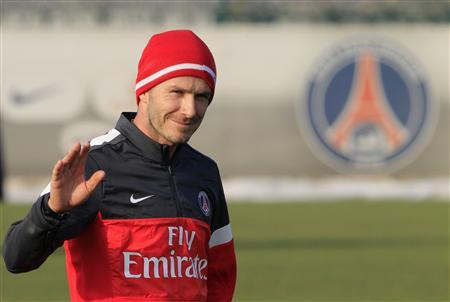 Paris Saint Germain's soccer player David Beckham waves as he attends his first training session with PSG squad at the Camp des Loges training center in Saint-Germain-en-Laye, near Paris, February 13, 2013. REUTERS/Gonzalo Fuentes