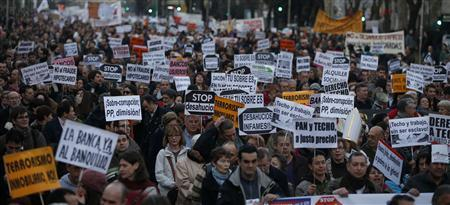 Anti-eviction protesters attend a demonstration in central Madrid in this February 16, 2013 file photo. REUTERS/Javier Barbancho/Files