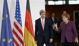 German Chancellor Angela Merkel and U.S. Secretary of State John Kerry arrive to address the media at the Chancellery in Berlin February 26, 2013. U.S. President Barack Obama will not bring a peace plan to Israel and the Palestinian Territories next month, but rather intends to listen, Kerry said on Tuesday. REUTERS/Fabrizio Bensch (GERMANY - Tags: POLITICS)