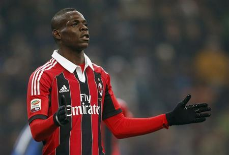 AC Milan's Mario Balotelli reacts after missing a goal opportunity against Inter Milan during their Italian Serie A soccer match at the San Siro Stadium in Milan February 24, 2013. REUTERS/Tony Gentile/Files