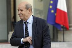 French Defence Minister Jean-Yves Le Drian leaves the Elysee Palace in Paris following a meeting on the situation in Mali, January 14, 2013. REUTERS/Philippe Wojazer