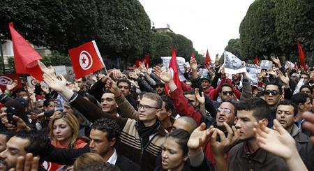 Tunisians chant slogans and hold pictures of assassinated leftist politician Chokri Belaid during a demonstration against the Islamist Ennahda movement in Tunis February 23, 2013. REUTERS/Zoubeir Souissi