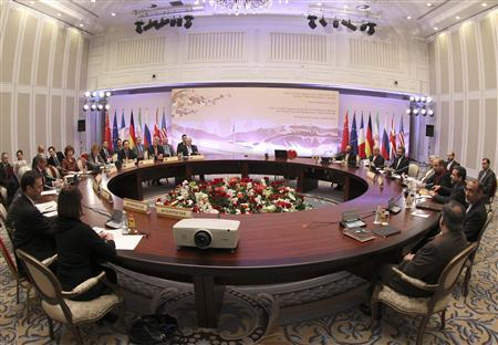 Participants sit at a table during talks on Iran's nuclear programme in Almaty February 26, 2013. REUTERS/Stanislav Filippov/Pool
