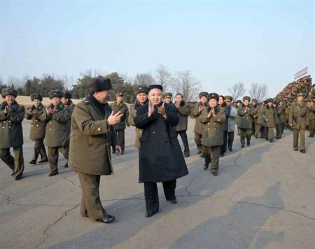 North Korean leader Kim Jong-Un (C) claps after inspecting an artillery firing drill of the Korean People's Army units in an undisclosed location in this undated recent picture released by the North's official KCNA news agency in Pyongyang February 26, 2013. REUTERS/KCNA